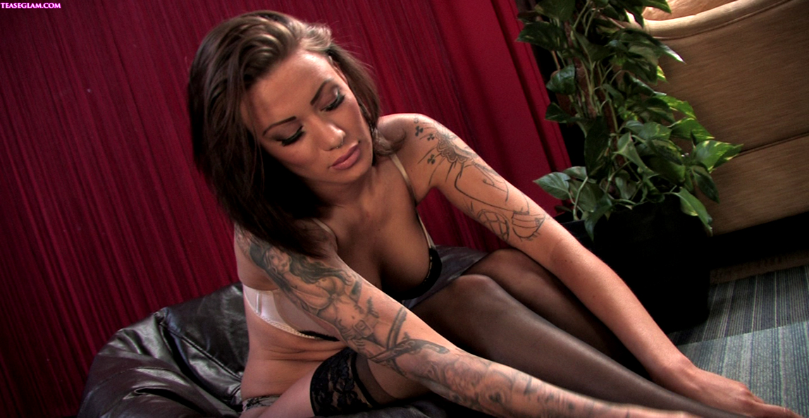 Stunning tattoed brunette black stockings