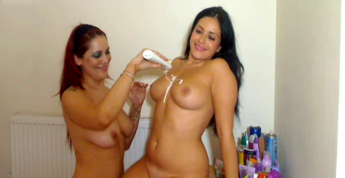 Elle rubs creamy lotion into Kerry's big tits