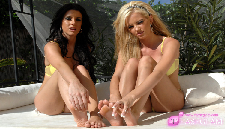 Fiona and Gemma cream their feet in the sun